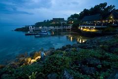 Dock (Bernie Led) Tags: blue sea green beach bar restaurant twilight dock perfect rocks photographer cove philippines grill resort cebu mactan the cowrie