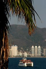 Acapulco vision (matthew_nan) Tags: sea sun mountain building tree beach digital canon buildings mexico eos boat ship hill wave palm vision palmtree acapulco estado messico guerrero 400d eos400d canoneos400d estadodeguerrero acapulcodejuarez acapulcovision matthewnan