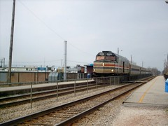 Southbound Amtrak train from Milwaukee Wisconsin passing through the Metra forest Glen commuter rail station on Chicago's far northwest side. Chicago Illinois. March 2007.