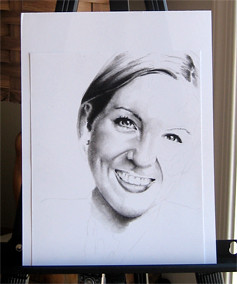 In progress photo of carbon pencil portrait entitled Ashley