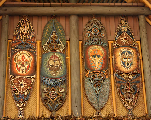 These tiki shields are above the exit to Walt Disney's Enchanted Tiki Room. Photo by Sam Howzit.