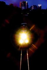4: get ready (WorldofArun) Tags: railroad blue sunset sky lake reflection minnesota speed train fence evening nikon downtown track dusk minneapolis rail august goods trail cedar planet locomotive behind 2008 roar economy freight bnsf 18200mm nikond40x yenumula worldofarun arunyenumula
