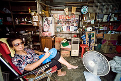 Home (TGKW) Tags: old portrait people woman home sunglasses shop lady hongkong fan chair sitting room chinese environmental elderly taio