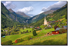 Heiligenblut (Fraggle Red) Tags: mountains church clouds austria sterreich village searchthebest krnten carinthia fields jpeg hdr canonefs1022mmf3545usm mlltal heiligenblut 3exp nationalparkhohetauern grosglockner platinumphoto dphdr