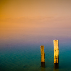 Pair (Khaled A.K) Tags: wood sea sky orange seascape green water clouds photography sticks surrealism surreal pit sa jeddah saudiarabia khaled waterscape ksa saudia tobaccofilter jiddah kashkari omluj