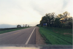 Driving Toward The Lac Qui Parle in the Steps of Bly (Monkey River Town) Tags: road trees sunset sky film minnesota sign rural wonderful print poetry poem alone ditch scan scanned fields mn sunroof bly robertbly highway40 timeandspace facingwest whatdoyouwant coryq mycollegedays 3taw50 asenseofselfandofconnectingwithsomeoneelse drivingtowardsthelacquiparle thissolitudewrappediniron juststandingtherelettingthesungodown ajourneyintoonesself coryfunk