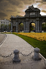 National Monument (Miles Away Photography) Tags: madrid park plaza city flowers sunset sun building green history tourism monument grass yellow stone architecture landscape grey design photo spain gate cityscape arch roundabout gray picture landmark cannon gateway granite historical archway processed hdr touristattraction nationalmonument sabatini attraction neoclassical underexposed commision shrapnel layered parquedelbuenretiro spaintrip plazadelaindependencia commemorate kingcarlos platinumhearts puertodealcala alcalagate flickrestrellas mandimiles mandimilesphotography