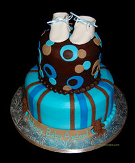 Brown, tan and blue 2 tier baby shower cake with baby booties and bears