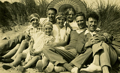 family fun on the beach (TinTrunk) Tags: family beach found coast 1930s seaside sand dune scan parasol oldphotograph hairnet
