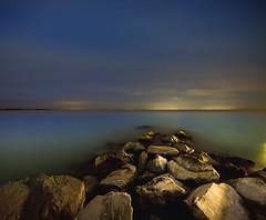 (Mute*) Tags: toronto water night stars landscape rocks nightshot flat 200iso lakeontario f63 sigma1020mm vertorama 196secs