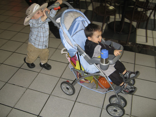 dylan pushing jax in the stroller