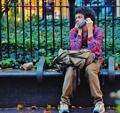 newyork fence bench manhattan broadway cellphone sneakers... (Photo: Ed Yourdon on Flickr)