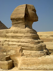 The Great Sphinx of Giza / Lower Egypt () Tags: africa man art cemetery grave graveyard sphinx architecture design ancient ruins flickr king desert pyramid northafrica profile lion egypt graves pharaoh desierto goldenage publicart egipto ramadan rtw giza gypten egitto egypte wste roundtheworld gizeh ancientegypt afrique dsert  antiquities globetrotter greathouse northernafrica    gyptien worldtraveler nemes aljizah   sphinxofgiza egyptische greatsphinx greatsphinxofgiza 4thdynasty gypter   nemesheaddress   ivdynasty 4 nemesheadcloth  desertumafricanum