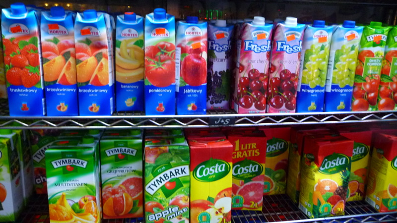 Colorful juice boxes outisde a Polish market
