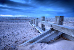 Findhorn Beach Groyne (freeskiing) Tags: longexposure blue winter sea cloud beach scotland highlands sand explore driftwood moray breakwater feburary findhorn sigma1020mm dramaticcloud highlandsofscotland ndgrad09 benthorburn