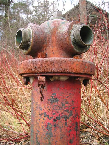Old rusted fire hydrant missing caps
