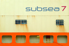 subsea 7 (archibaldo) Tags: windows orange yellow logo rust ship name vessel seven hull streaks openings barred subsea
