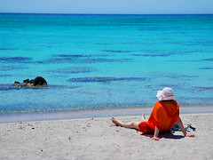 Summer dreams (Elafonisi, Crete) (MarcelGermain) Tags: blue red sea summer vacation sky people orange woman beach water hat geotagged greek mar sand nikon holidays rocks mediterranean horizon aegean creta greece crete verano myfavourites sunbathing platja estiu chania mediterrani et grcia      d80 mywinners marcelgermain