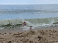 Kid crashing wave