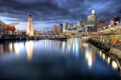 Darling Harbour (Pawel Papis Photography) Tags: lighthouse reflection beautiful night buildings lights sydney australia nsw darlingharbour soe cityatnight dask flickrsbest golddragon canon400d aplusphoto theperfectphotographer multimegashot damniwishidtakenthat