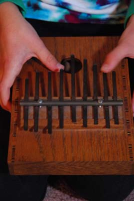 playing the thumb piano