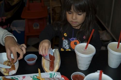 Mina prepares her hot dog