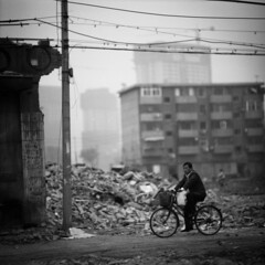 requiem (memetic) Tags: china street bw man 6x6 bicycle buildings asian uncut blackwhite cyclist tmax chinese demolition 100  vanishing tianjin rubble  arax60 disappearing autaut lpbicycles