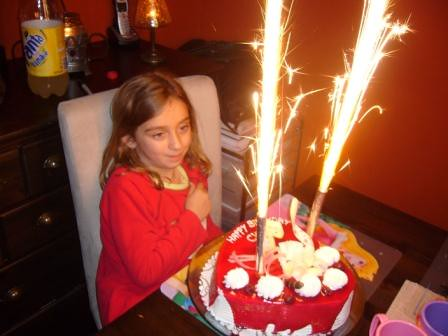 "Chloe with her Birthday cake and ""Firework"" Candles, they surprised us all!"