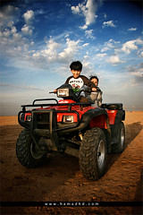Wonderful Day (Hamad Al-meer) Tags: red sky sahara bike canon wonderful eos day child desert sunny motorbike hd kuwait hamad 30d   almeer   hamadhd hamadhdcom wwwhamadhdcom