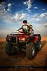 Wonderful Day (Hamad Al-meer) Tags: red sky sahara bike canon wonderful eos day child desert sunny motorbike hd kuwait hamad 30d حمد كويت almeer كانون المير hamadhd hamadhdcom wwwhamadhdcom