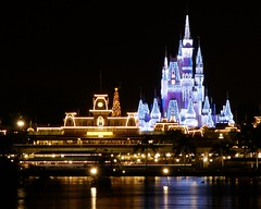 Magic Kingdom - Cinderella's Winter Castle (Matt Pasant) Tags: christmas longexposure blue water night lights purple ttc wed disney explore trainstation mickeymouse newyears monorail wdw waltdisneyworld icicles magickingdom waltdisney cinderellascastle baylake sevenseaslagoon ticketandtransportationcenter