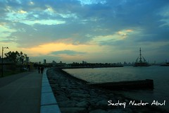 A nice day to walk (Sadeq Nader Abul) Tags: sunset marina canon eos waves kuwait nader sadeq   abul    400d