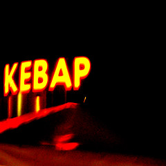 meats of mystery & imagination (DREASAN) Tags: light red urban black blur berlin yellow night word typography neon letters grain advertisement kebab hbf centralstation lackoffocus dnerbude lof notrecommendable dreasanavb