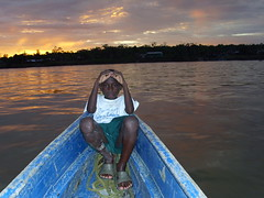 Child sailing in the river Atrato (Blanca Oviedo) Tags: river evening sailing along atrato