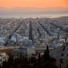 Greece - Athens - Looking towards Piraeus (Darrell Godliman) Tags: city travel sunset copyright travelling tourism nikon europe tramonto cityscape sonnenuntergang dusk eu athens greece squareformat getty gr puestadesol d200 viewpoint sq  allrightsreserved coucherdesoleil piraeus saronicgulf gnbatm  travelphotography  nikond200 instantfave 5photosaday  omot saronicislands travelphotographer flickrelite dgphotos darrellgodliman wwwdgphotoscouk dgodliman