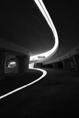 Under the highway (u_sperling) Tags: light shadow blackandwhite bw usa sanantonio geotagged interesting highway texas great curve 1on1 1on1planestrainsautos 1on1planestrainsautosphotooftheweek 1on1planestrainsautosphotooftheweekjune2008 geo:lat=29454733 geo:lon=98481896