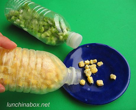 Frozen corn in plastic water bottle