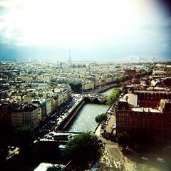 ah, paris! (golfpunkgirl) Tags: city sky paris france mediumformat lomo lomography cathedral eiffeltower diana riverseine may2008 agfaoptima160 viewfromnotredame