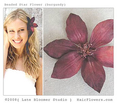 Girl_Wearing_Burgundy_Flower_In_Hair (hairflowers.com) Tags: wedding red vacation orchid flower beach rose hair honeymoon silk clip tropical bridal gardenia flowerhairclip flowerforhair bridalflowerhairclip weddingflowerhair gardeniaflowerforhair