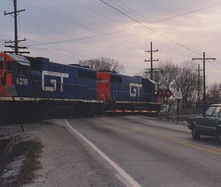 Northbound Grand Trunk western freight train crossing 123rd Street. Alsip Illinois USA. April 1990. by Eddie from Chicago