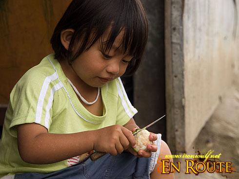 Sagada Child Peeling a fruit