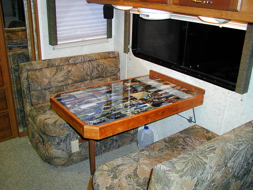 Original  Table Into An Area That Houses A Desk With Cabinets And Has Table