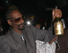 snoop dogg with a bottle of ace of spades