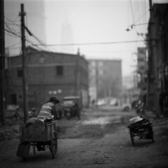 rounds (memetic) Tags: china street bw 6x6 buildings asian uncut blackwhite cyclist tmax chinese demolition cycle 100  vanishing tianjin rubble  arax60 disappearing
