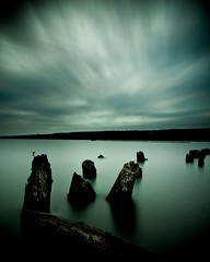 cold shoulder ([Adam Baker]) Tags: longexposure water clouds canon dark movement decay alien surreal pylon portfolio adambaker 40d ndx400 tokina1116 tonkina1116