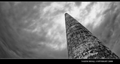 Sugar Tower (Fraggle Rockstar) Tags: old blackandwhite tower clouds contrast dark hawaii vanishingpoint nikon industrial cloudy antique maui rainy nikkor 16mm f28 extraordinary lahaina standpipe bold ais sugarmill superaplus aplusphoto atqueartificia