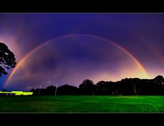 Rainbow ([ Kane ]) Tags: blue sky orange storm colour green rain yellow rainbow colours spectrum explore kane continuous gledhill aplusphoto kanegledhill sevenfoldred indigoandviolet kanegledhillphotography