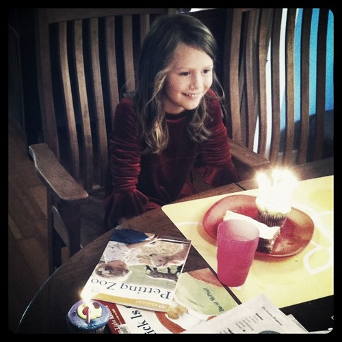 "Ada enjoying ""happy birthday"" sung by 3 good friends (small party; everyone got a candle"