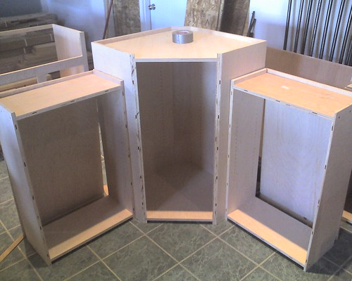 Three of the upper cabinets, without face frames yet.