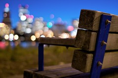 Have a seat (shetha) Tags: wood city longexposure sunset skyline night oregon river bench portland lights raw dof bokeh seat tripod perspective nuts bolts pdx willametteriver aperture2 bokehwednesday goldenvisions bokehhappiness bokehcardpdx